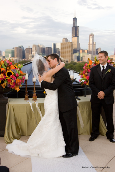 bride-and-groom-kissing-on-roof