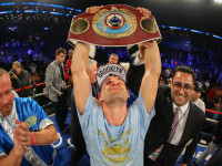 Chris Algieri holding his WBO Light Welterweight Championship belt